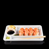 Sushi rolls made of fresh raw salmon, cream cheese and avocado in white plastic container ready to eat on black Stock Images