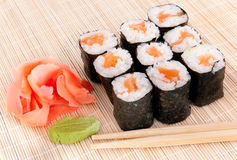 Sushi rolls on mat with chopsticks Royalty Free Stock Photo