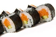 Sushi Rolls med laxen och gurkan fotografering för bildbyråer