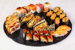 Sushi and rolls mix. Plate assortment set stock photography