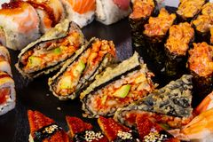 Sushi and rolls mix. Plate assortment set royalty free stock photo
