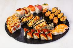 Sushi and rolls mix. Plate assortment set stock images