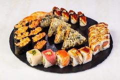 Sushi and rolls mix. Plate assortment set royalty free stock photography