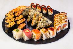 Sushi and rolls mix. Plate assortment set royalty free stock image