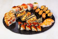 Sushi and rolls mix. Plate assortment set royalty free stock photos