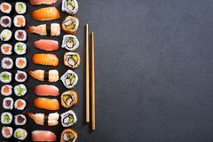 Sushi rolls and nigiri background stock image