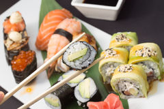 Sushi rolls and nigiri Stock Images