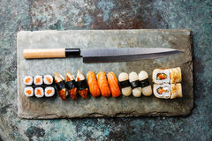 Sushi rolls and nigiri with Japanese knife Royalty Free Stock Photo