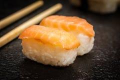 Sushi rolls nigiri. Traditional japanese sushi  nigiri  and chopsticks on stone desk Royalty Free Stock Image