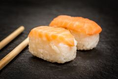 Sushi rolls nigiri. Traditional japanese sushi  nigiri  and chopsticks on stone desk Royalty Free Stock Photos