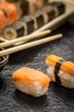 Sushi rolls nigiri. Traditional japanese sushi nigiri and chopsticks on stone desk Stock Image