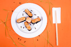 Sushi. And rolls on the orange font Royalty Free Stock Photos