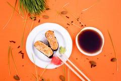 Sushi. And rolls on the orange font Royalty Free Stock Image