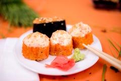 Sushi. And rolls on the orange font Royalty Free Stock Photo