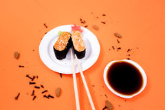 Sushi. And rolls on the orange font Stock Photos
