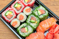Sushi, rolls and pickled ginger on a bamboo board close-uр Stock Photo