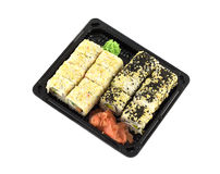 Sushi rolls in plastic container isolated on white closeup Royalty Free Stock Images