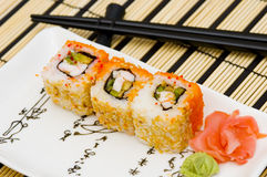 Sushi (rolls) on a plate. Chopsticks, wasabi royalty free stock photography