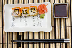 Sushi (rolls) on a plate Stock Image