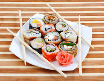 Sushi rolls on the plate with chopsticks Stock Image