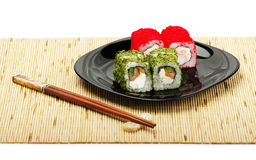 Sushi rolls on a plate Royalty Free Stock Images