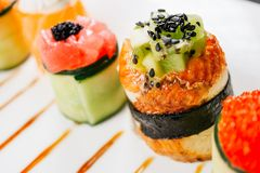 Sushi rolls on plate, gourmet seafood delicatessen stock photos