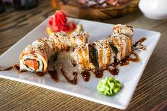 Sushi and rolls in plate. Japanese favorite food sushi. Sushi and rolls stock image