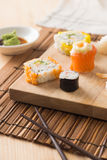 Sushi with rolls on the plate Stock Photography