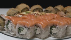Sushi rolls on a plate side view camera moves from left to right. Cooking stock video