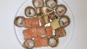 Sushi rolls on a plate top view plate spinning stock video footage
