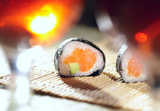 Sushi rolls and plum wine. Royalty Free Stock Photo