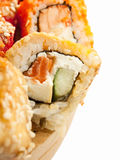 Sushi rolls in range on the desk closeup isolated Stock Photography