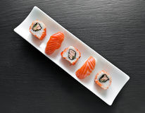 Sushi and rolls Stock Images