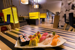 Sushi rolls in restaurant. Royalty Free Stock Image