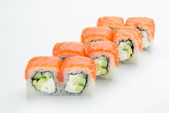 Sushi rolls with salmon, avocado,  philadelphia and cucumber   on white background Royalty Free Stock Photography