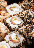 Sushi rolls with salmon and black caviar Royalty Free Stock Photos
