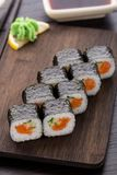 Sushi rolls with salmon and cucumber Stock Photos