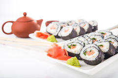 Sushi rolls with salmon and green tea Royalty Free Stock Photo