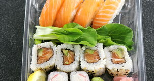 Sushi rolls with salmon. In plastic container stock footage