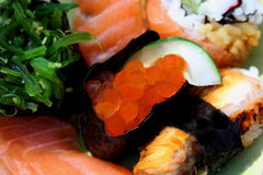 Sushi rolls with salmon,red caviar and eel Stock Photos