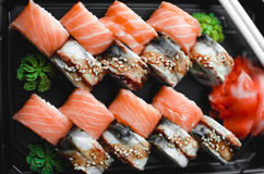 Sushi rolls salmon. Sushi rolls served on a plastic plate under the order Stock Images
