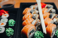 Sushi rolls salmon. Sushi rolls served on a plastic plate under the order Royalty Free Stock Photography