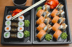 Sushi rolls salmon. Sushi rolls served on a plastic plate under the order Stock Photos