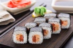 Sushi rolls with salmon teriyaki Royalty Free Stock Image