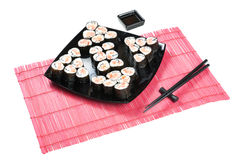 Sushi rolls. With salmon and tomato on a black square plate Royalty Free Stock Photography