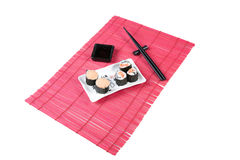 Sushi rolls. With salmon and tomato on a black square plate Royalty Free Stock Image
