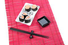 Sushi rolls. With salmon and tomato on a square plate Royalty Free Stock Photography