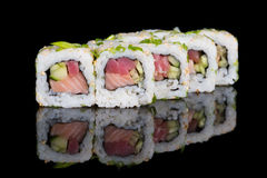 Sushi rolls with salmon, tuna, cucumber and green onions Stock Images