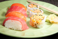 Sushi Rolls and Sashimi Stock Image