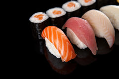 Sushi rolls and sashimi Royalty Free Stock Photography